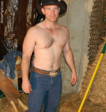handsome ranch hand working shirtless barn.jpg