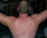 000flexing big arms college dorm room gym.jpeg