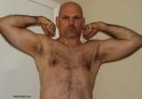 hairy pro wrestler goatee flexing arms.jpg