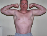 irish muscle dad flexing arms.jpg