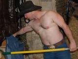 ranch hand shoveling barn working.jpg