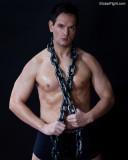 sweaty muscle stud chains around neck.jpg