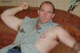 uncle brad flexing arms torn shirt.jpg