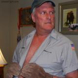 handsome rugged trucker daddy opening shirt.jpg
