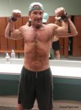 muscular ripped guy flexing gym mirror.jpg