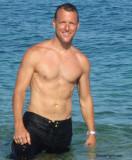 hunky wet hawaii muscle stud gay dude.jpg
