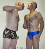 army military dudes face punching pec pounding.jpg