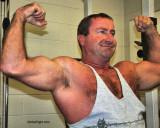 massive arms hairy daddybear flexed biceps.jpg