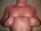 hairy dad playing with nips.jpg