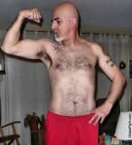 tight body older silver daddy flexing.jpg
