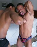 black muscle men pec punching.jpg
