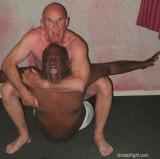 gay male couple wrestling.jpg