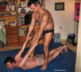 gay man arms pinned behind his back.jpg