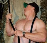 a muscleman wearing baseball cap pulling rope.jpg