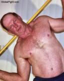 a stick fighting daddie stretching workout sweaty.jpg