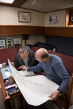 Going over charts with a fellow captain