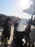 Gathering around the incense burner at Kiyomizudera Temple