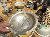 Tiny gold grain found at Kassola, near Tiébélé, Centre-Sud Region, Burkina Faso