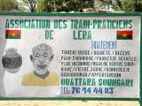 Roadside advertisement of healer and soothsayer Ouattara Soungari in Lera (Senufo tribe), Burkina Faso.