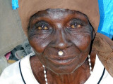 Lobi woman wearing the traditional small wooden disc above her upper lip, Burkina Faso