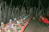 Preparing for dinner in a traditional African boma