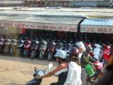 Motorscooters everywhere in Vietnam, and the riders wore facemasks to avoid breathing the fumes.