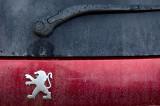 The legend of Ron (burgundy Peugeot)