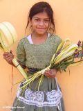 Girl selling palm weaving