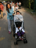 Pushing Zoya in the stroller with Sachi.