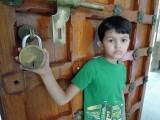Examining a Godrej lock at the museum door