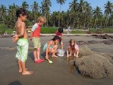 With friends inspecting a crab