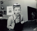 Starting early:  Bill attempting to hide an egg in his overalls.  (c. 1946)