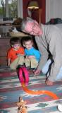 Imbuing his grandchildren with passion.  (c. 2002)