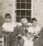 Grandfather Scott with Bill, Rick, and Mary -- and eggs.  (1945)