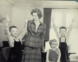 Granny claimed she had just asked the three to raise their hands if they threw the egg.  (c. 1946)