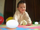 Infant Rahil with toy eggs.