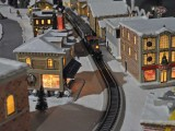 Train comes down the track on Jim's Christmas layout