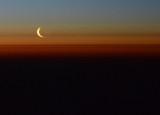 Crescent moon low on the polar horizon