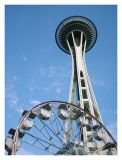 The Space Needle Rises Above Seattle Center Ferris Wheel