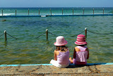 Two little girls at rockpool