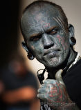 Heavily tattooed man in close up
