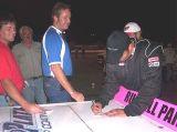 Nicholas signing autographs