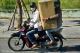 holding large box, Da Nang, Vietnam