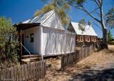 Slab hut and church