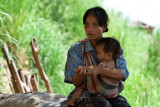 Laotian mother and children on this border town