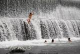 Kids enjoying a swim from the spillway  of a dam _CWS7235.jpg