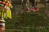 Children watched from the homes as the procession went through the village _MG_2134.jpg