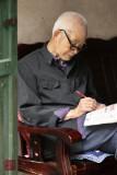 Enjoying a puzzle, Xing Ping, China