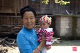 Lady and grandchild, Da Zai village, Long Ji, China.