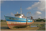 Bâteau de pêche à marée basse